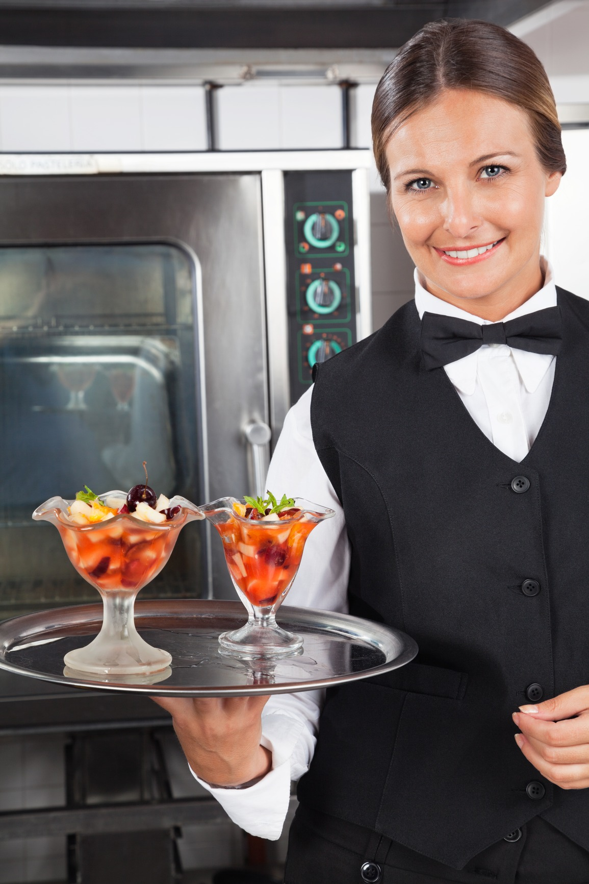 Happy Waitress Holding Dessert Tray