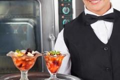 Happy Waitress Holding Dessert Tray